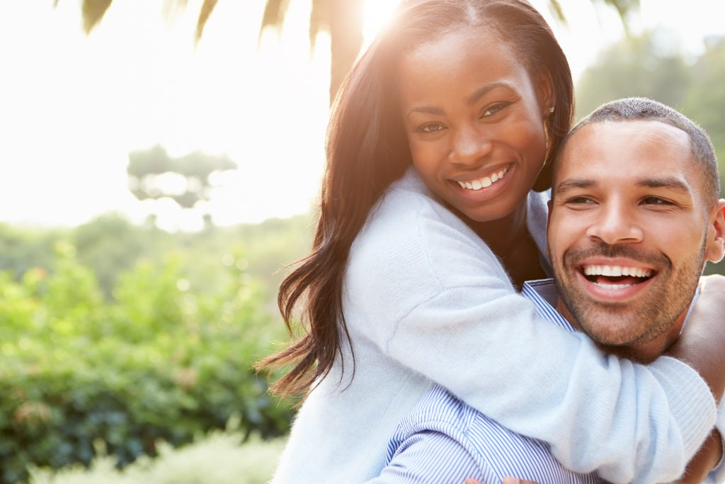 Image of a happy couple who just learned about at-home teeth whitening in Lincoln, NE.
